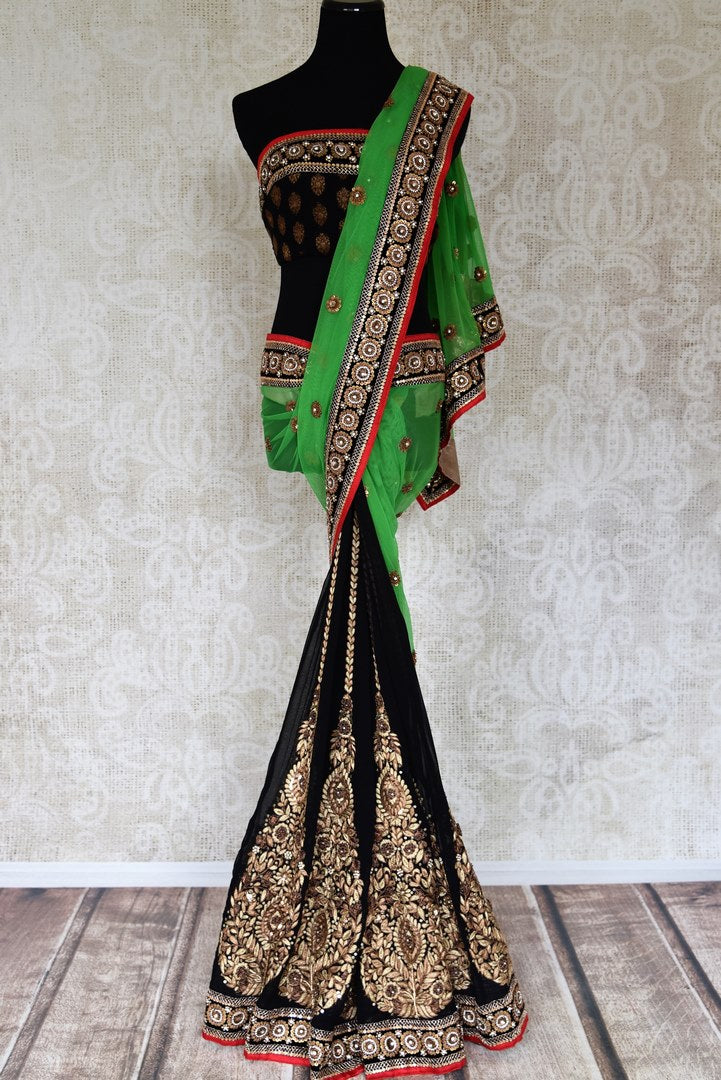 Shop green net and black georgette half n half embroidered saree online in USA from Pure Elegance. Let your ethnic style be one of a kind with an exquisite variety of Indian handloom sarees, pure silk sarees, designer sarees from our exclusive fashion store in USA.-full view