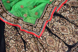 Shop green net and black georgette half n half embroidered saree online in USA from Pure Elegance. Let your ethnic style be one of a kind with an exquisite variety of Indian handloom sarees, pure silk sarees, designer sarees from our exclusive fashion store in USA.-details