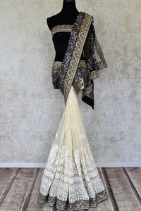 Shop off-white and black half n half embroidered net sari online in USA from Pure Elegance. Make your ethnic style perfect with a range of exquisite Indian designer saris, embroidered sarees, handloom saris available at our exclusive Indian fashion store in USA and also on our online store. Shop now.-full view