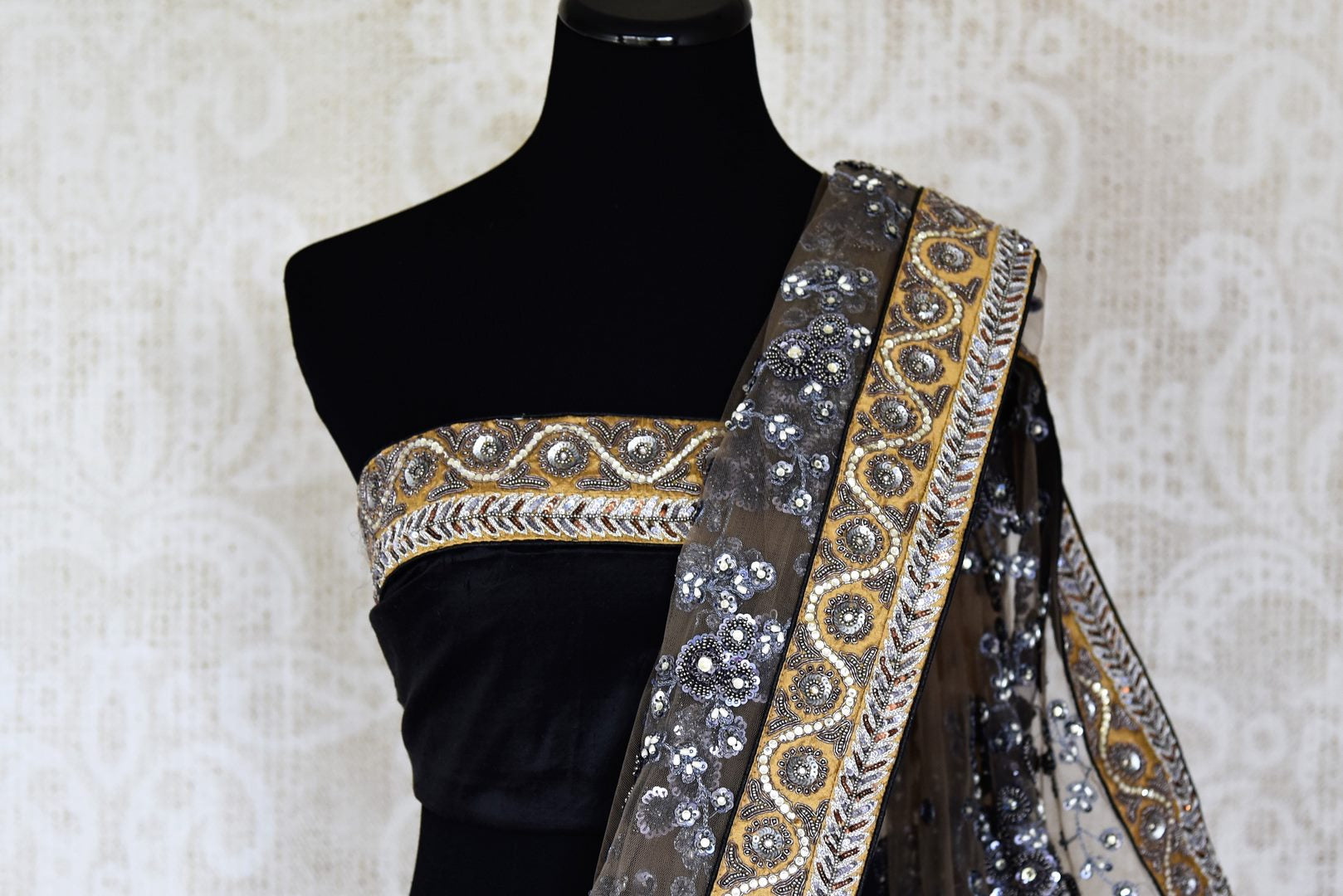Shop off-white and black half n half embroidered net sari online in USA from Pure Elegance. Make your ethnic style perfect with a range of exquisite Indian designer saris, embroidered sarees, handloom saris available at our exclusive Indian fashion store in USA and also on our online store. Shop now.-blouse pallu