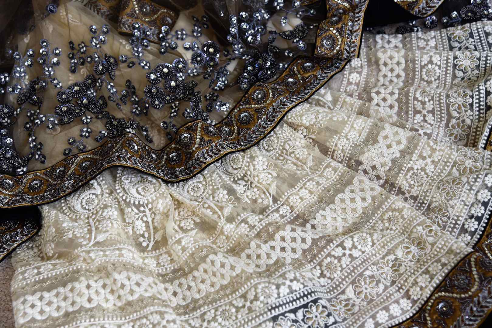Shop off-white and black half n half embroidered net sari online in USA from Pure Elegance. Make your ethnic style perfect with a range of exquisite Indian designer saris, embroidered sarees, handloom saris available at our exclusive Indian fashion store in USA and also on our online store. Shop now.-details
