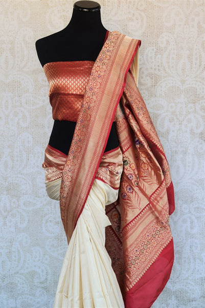 90B240 Traditional off white and red Banarasi silk saree that makes for an evergreen Indian outfit. This saree available online at Pure Elegance is ideal for Indian wedding functions and receptions.