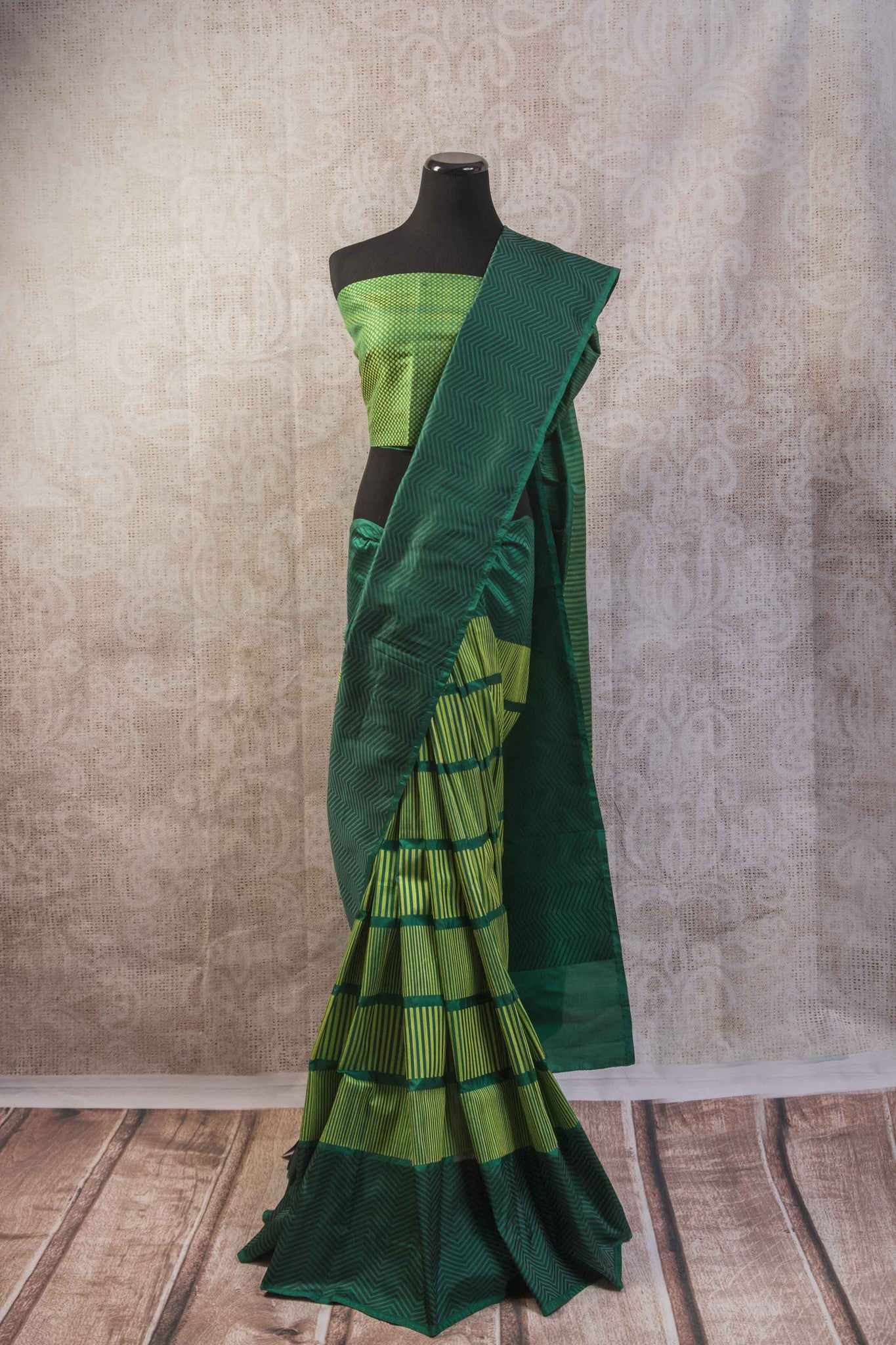 90b256 Multi green Banarasi silk saree with zig zag stripes & satin black pallu. The simple sari is available at our Indian clothing store in USA, Pure Elegance. This one is perfect for parties, get-togethers and functions!