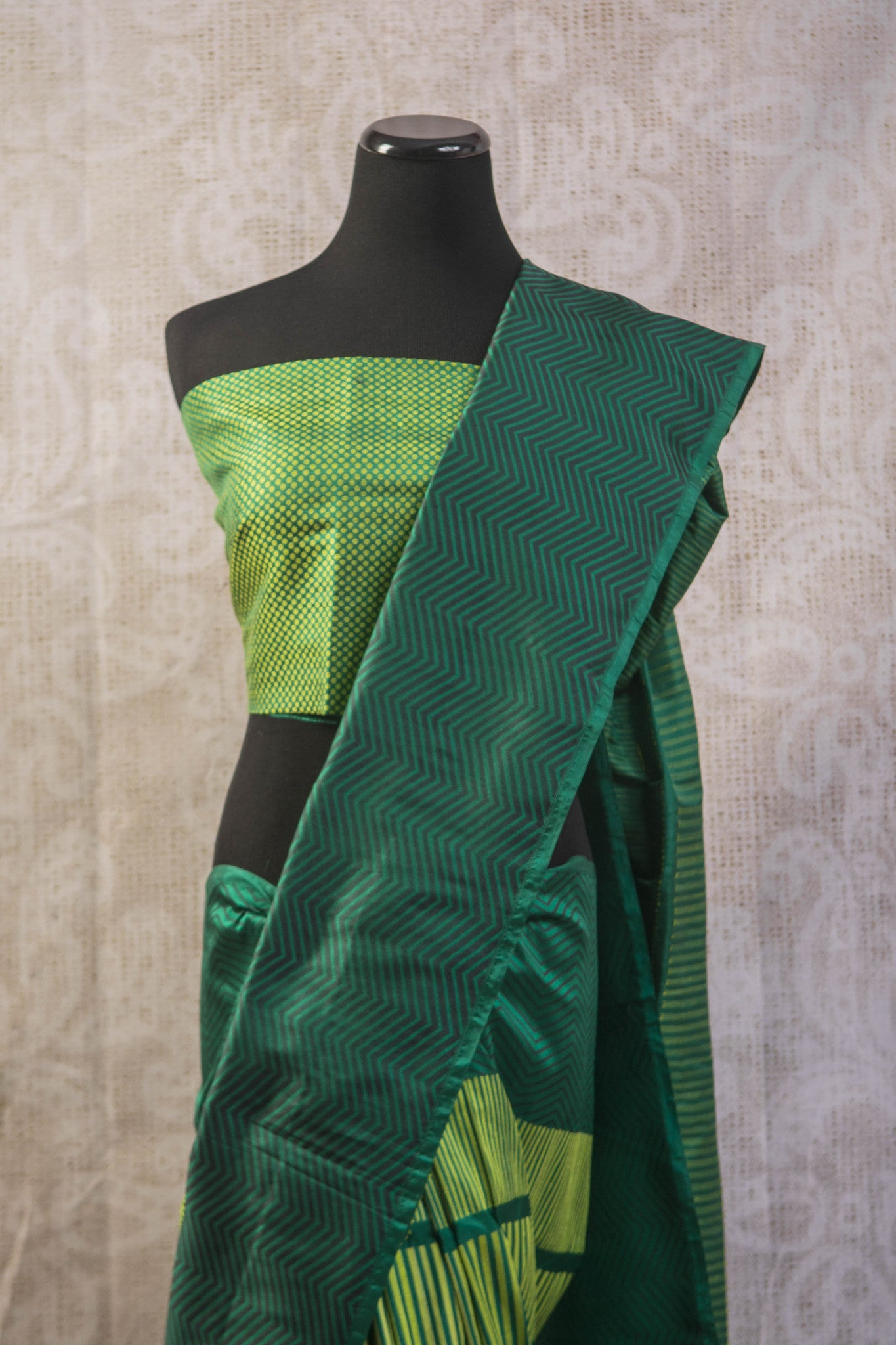 90b256 Multi green Banarasi silk saree with zig zag stripes & satin black pallu. The simple sari is available at our Indian clothing store in USA, Pure Elegance. This ethnic outfit is a great pick for parties, get-togethers and functions!