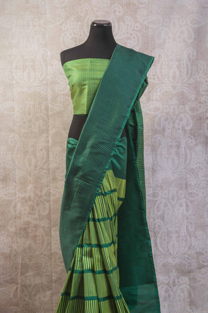 90b256 Multi green Banarasi silk saree from India with zig zag stripes & satin black pallu. The simple sari is available at our Indian wear store in USA, Pure Elegance. This one is perfect for parties, get-togethers and pujas.