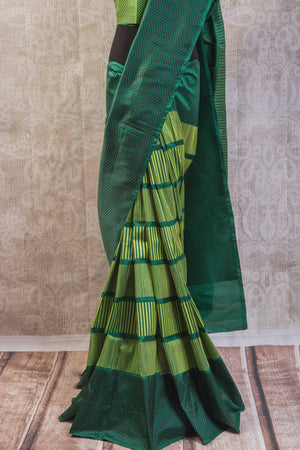 90b256 Multi green Banarasi silk saree with zig-zag stripes & satin black pallu. Buy this simple sari online at our Indian clothing store in USA, Pure Elegance. This one is perfect for pujas, get-togethers and functions!