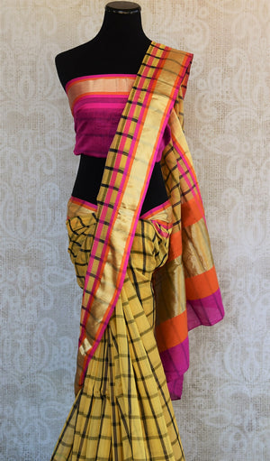 90B342 Buy this chanderi cotton silk Indian saree online at Pure Elegance - our ethnic fashion store that houses amazing sarees, suits and lehengas. The checked yellow sari with a golden, pink & orange border is suitable Indian outfit for weddings & parties