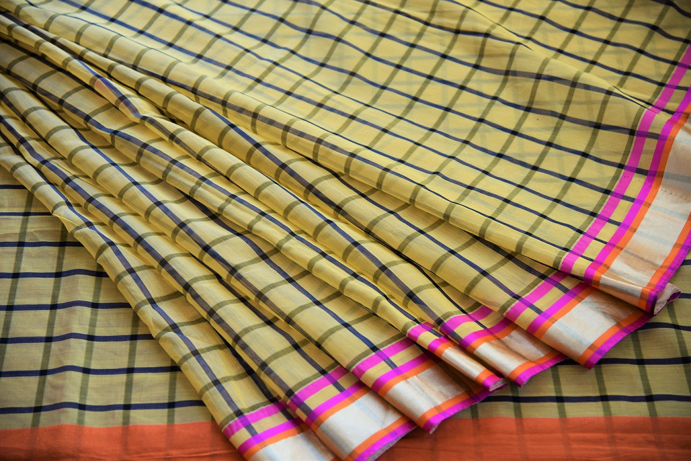 90B342 Buy this chanderi cotton silk saree online in USA at our store - Pure Elegance. The checked yellow sari with a golden, pink & orange border makes for a great Indian outfit for weddings and festive occasions.