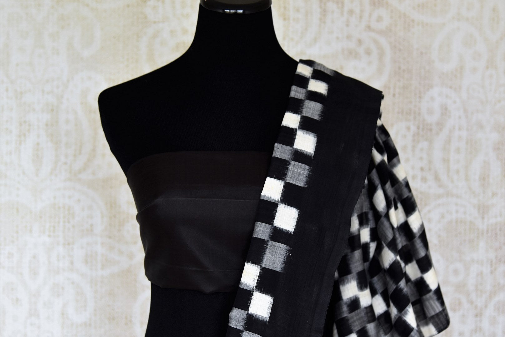 Shop black grey and white square ikkat cotton saree online in USA. Shop more such exquisite Indian handloom saris in USA from Pure Elegance. Get floored by a range of designer sarees, pure silk sarees, Kanchipuram silk saris at our Indian fashion store in USA.-blouse pallu