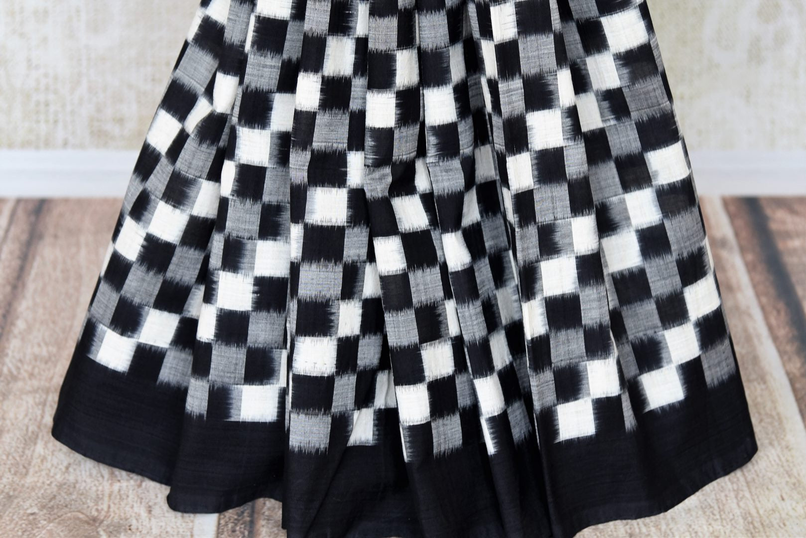 Shop black grey and white square ikkat cotton saree online in USA. Shop more such exquisite Indian handloom saris in USA from Pure Elegance. Get floored by a range of designer sarees, pure silk sarees, Kanchipuram silk saris at our Indian fashion store in USA.-pleats