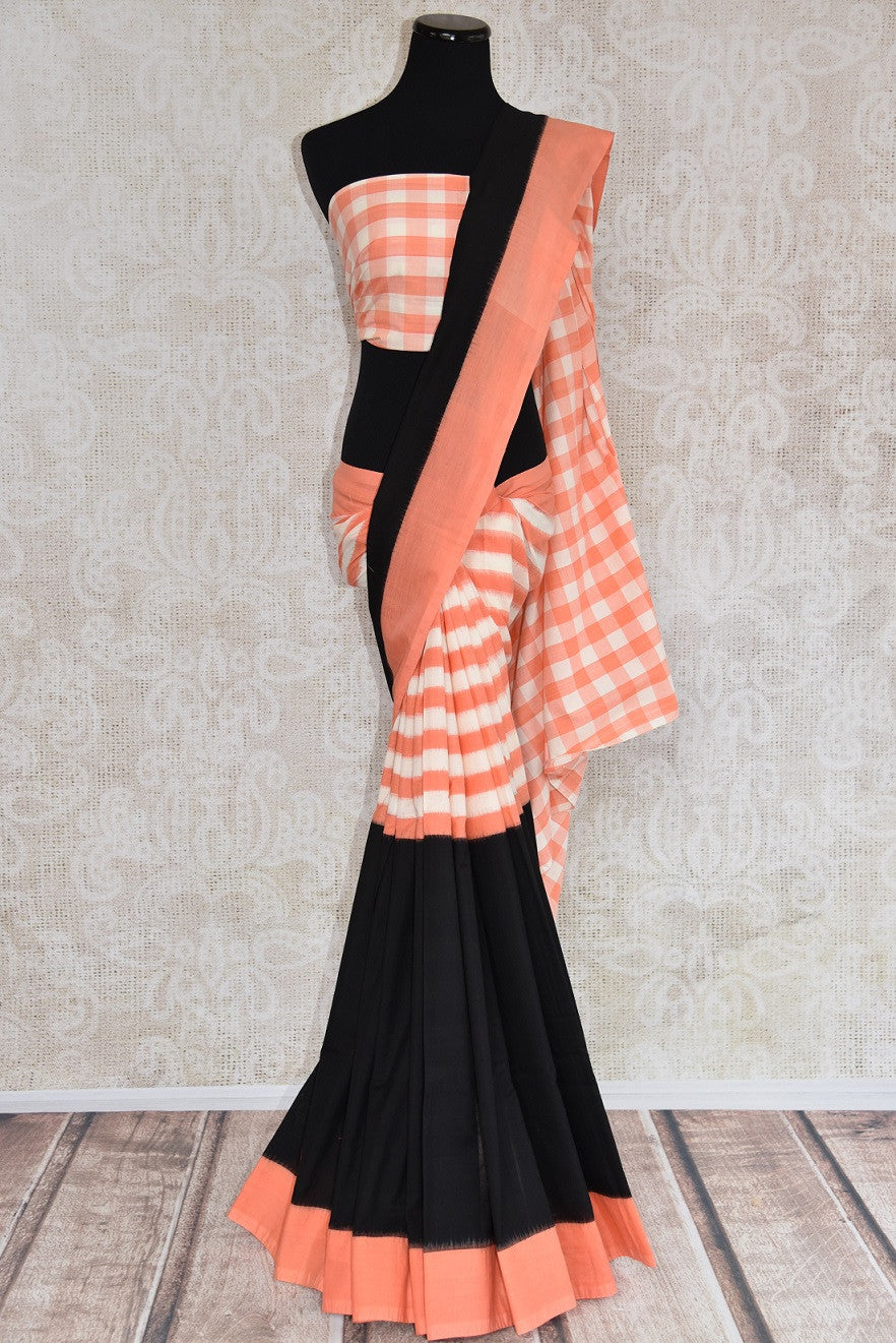 90B392 Orange, white & black cotton ikkat saree, available at our Indian clothing store online in USA. The checked & striped saree will be a great addition to your ethnic wear wardrobe.