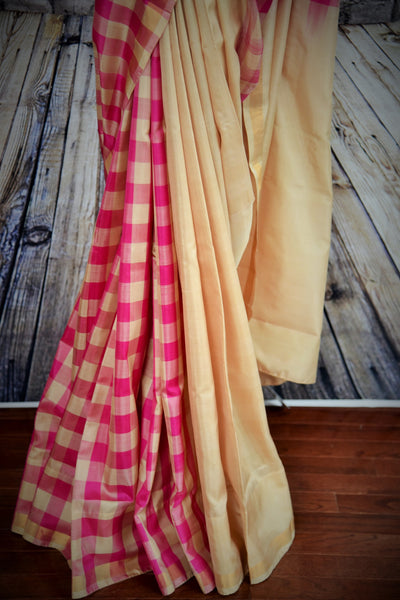 90b394 Buy this refreshingly gorgeous Banarasi saree online at our Indian fashion store online in USA - Pure Elegance. The beige and pink, half checked, half plain sari is versatile and perfect to wear for parties and Indian festive occasions.