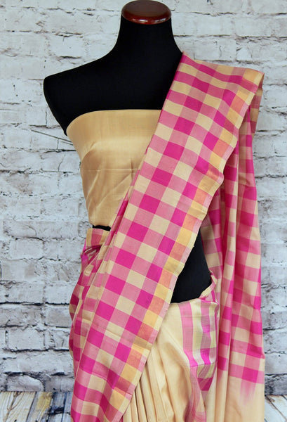 90b394 Buy this charming Indian Banarasi saree online in USA at our ethnic store - Pure Elegance. The half checked, half plain, beige and pink sari is versatile and perfect to wear for parties and Indian festive occasions.