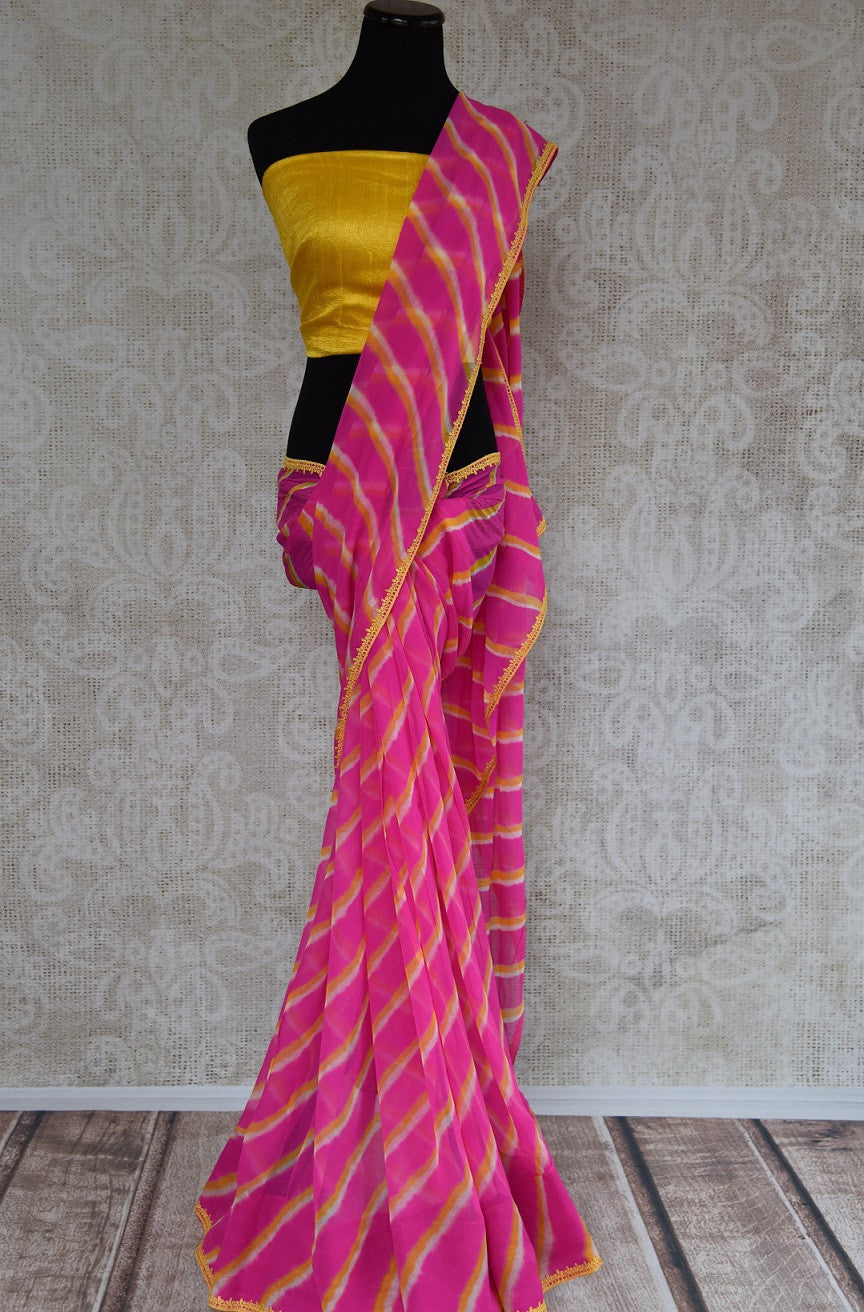 90B398 Lovely leheriya pink & yellow saree with yellow blouse, great for Indian wedding functions like mehendi functions and festive occasions. The chiffon saree from India can be bought online at our online Indian clothing website - Pure Elegance.