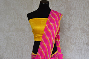 90B398 Alluring pink & yellow leheriya saree online in USA with yellow blouse, great for Indian wedding functions like mehendi functions and festive occasions. The chiffon saree from India can be bought at our Indian clothing website - Pure Elegance.