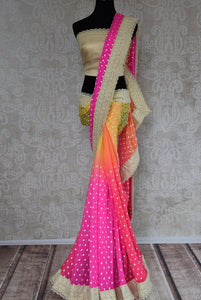 90B425 Vibrant pink, yellow, green & orange, shaded georgette saree with lace border. The multi-colored ethnic saree makes for a great Indian outfit for wedding functions. Buy it online at Pure Elegance.