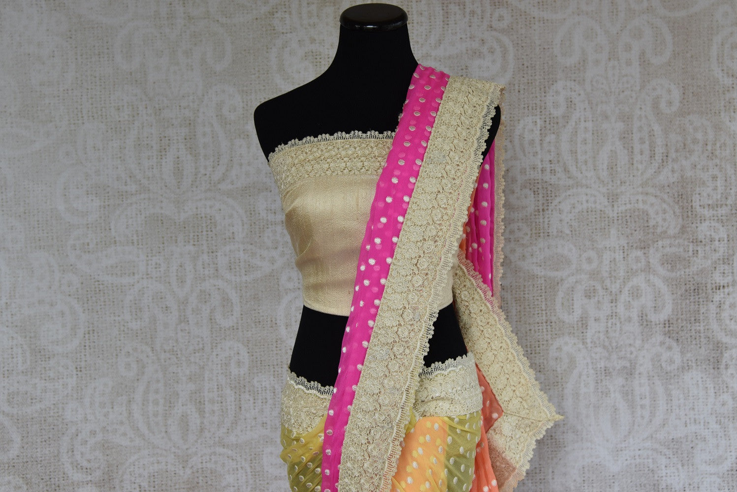 90B425 Vibrant pink, yellow, green & orange, shaded saree with a lovely lace border. The multi-colored ethnic georgette saree makes for a great Indian outfit for wedding functions. Buy it online in USA at Pure Elegance.