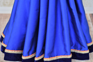 Shop royal blue crepe silk embroidered designer saree with blouse online in USA from Pure Elegance. Let your ethnic style be one of a kind with an exquisite variety of Indian handloom sarees, pure silk sarees, designer sarees from our exclusive fashion store in USA.-pleats