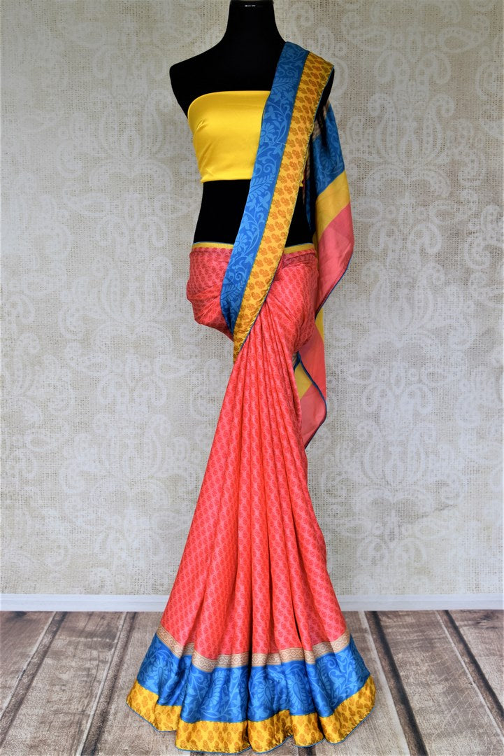 Buy salmon pink prined crepe saree online in USA with blue and yellow border. Elevate your ethnic style on weddings and festive occasions with stunning designer sarees, pure silk sarees, crepe sarees, printed sarees from Pure Elegance Indian fashion boutique in USA.-full view