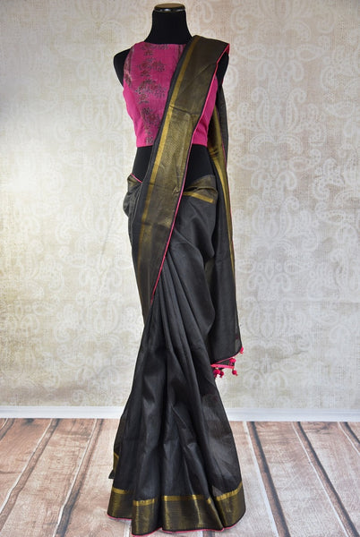 90B505 Charcoal grey bhagalpur tussar saree with golden border. This Indian outfit available online at Pure Elegance is perfect for Indian wedding receptions & parties. Versatile and eye-catching, you'll love having this saree in your wardrobe.