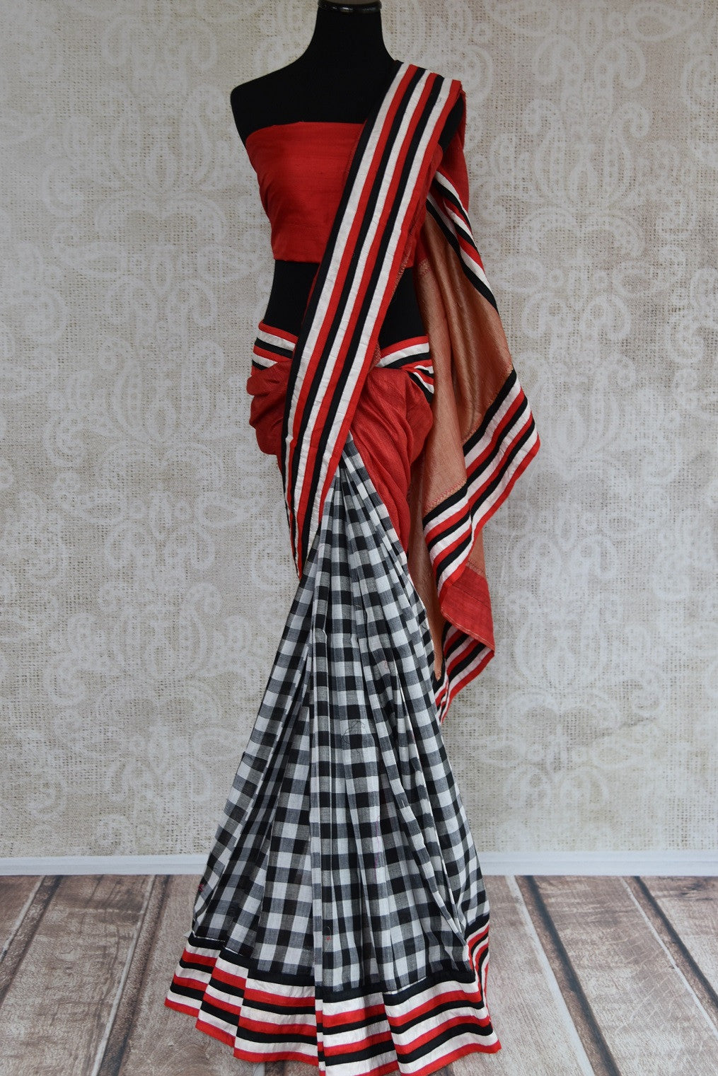 90B508 Bold half-matka and half chanderi party wear saree. The black, white and red saree also has checks and can be bought online at our Indian fashion store in USA.