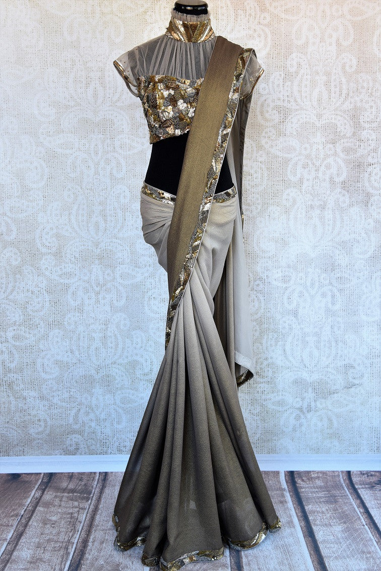 90B551 This shimmer georgette saree from India is strikingly beautiful. The shaded grey saree is topped with a bronze border & sequin & crystal work. Add it to your party sarees collection today!