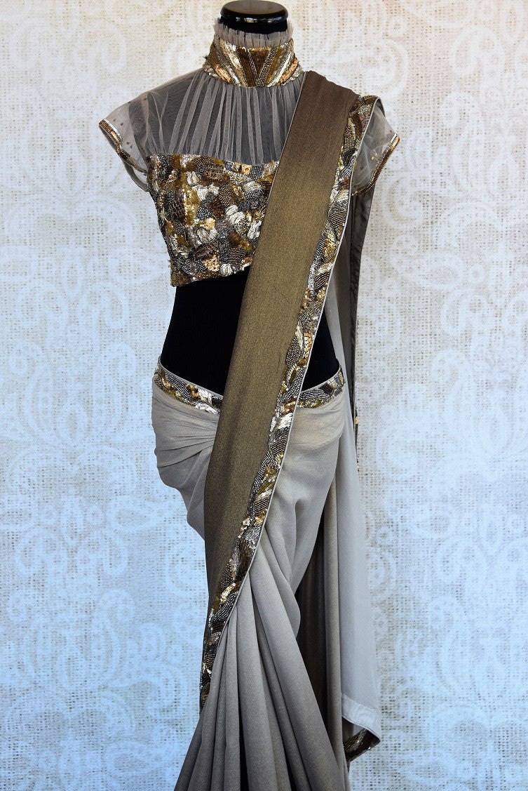 90B551 This shimmer georgette saree from India available online in USA at Pure Elegance, is strikingly beautiful. The shaded grey saree is topped with a bronze border & sequin & crystal work. Add it to your party sarees collection today!