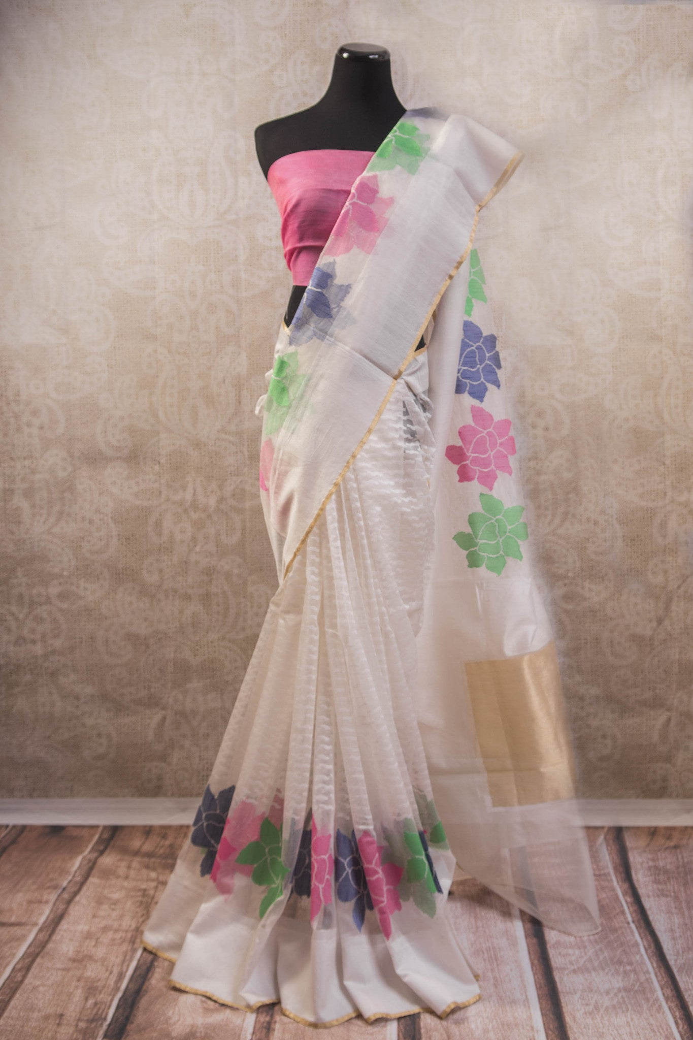 90b604 Buy this sheer white textured jute Banarasi saree online at Pure Elegance. The floral saree comes with a pink blouse & is a great Indian outfit to wear at parties and ethnic functions. This charming Indian saree is something you'll love having in your ethnic wear wardrobe for years to come!