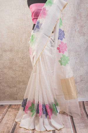 90b604 Buy this sheer white textured jute Banarasi saree online at Pure Elegance in USA. The lovely floral saree comes with a pink blouse & is a wonderful ethnic outfit to wear at parties and festive occasions. Thi Indian saree is something you'll love having in your Indian wear wardrobe for years to come!
