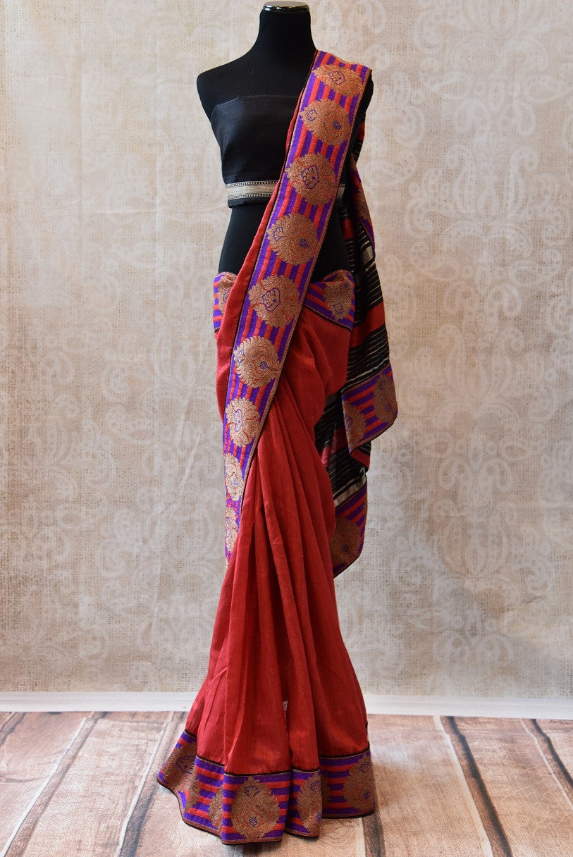 Red raw silk saree with beautiful banarasi border. This ethnic sari comes with black silk blouse and good for Indian events.-Full view