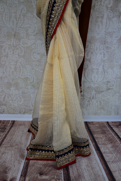 90B694 Simple zari kota saree online in USA with zardozi embroidery and sequined border. Buy this classic cream, black & red Indian outfits from Pure Elegance - our ethnic fashion store.