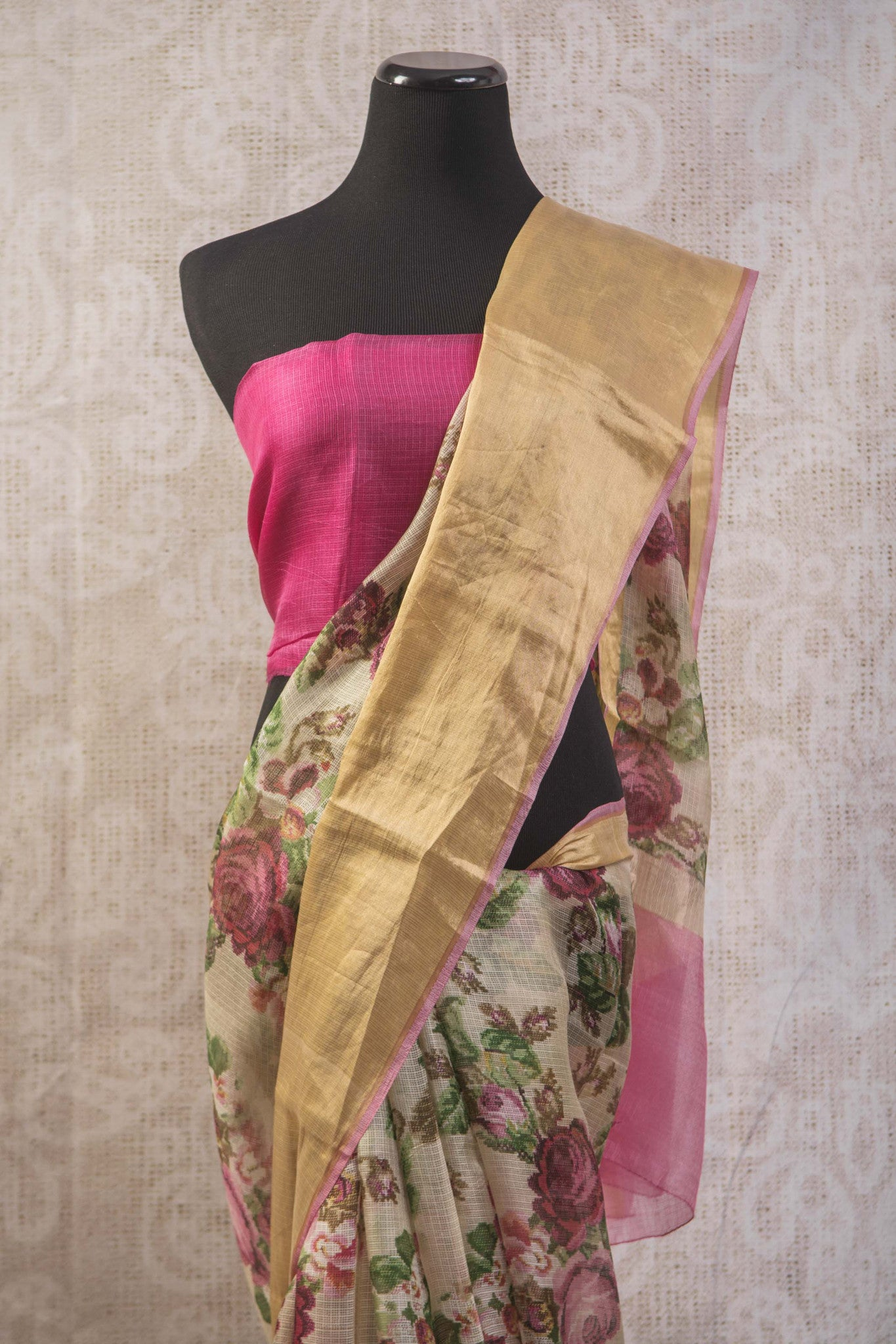 90b745 Indian zari kota saree online at Pure Elegance with gold trim border and an un-stiched pink blouse piece. This printed floral saree is an evergreen pick!