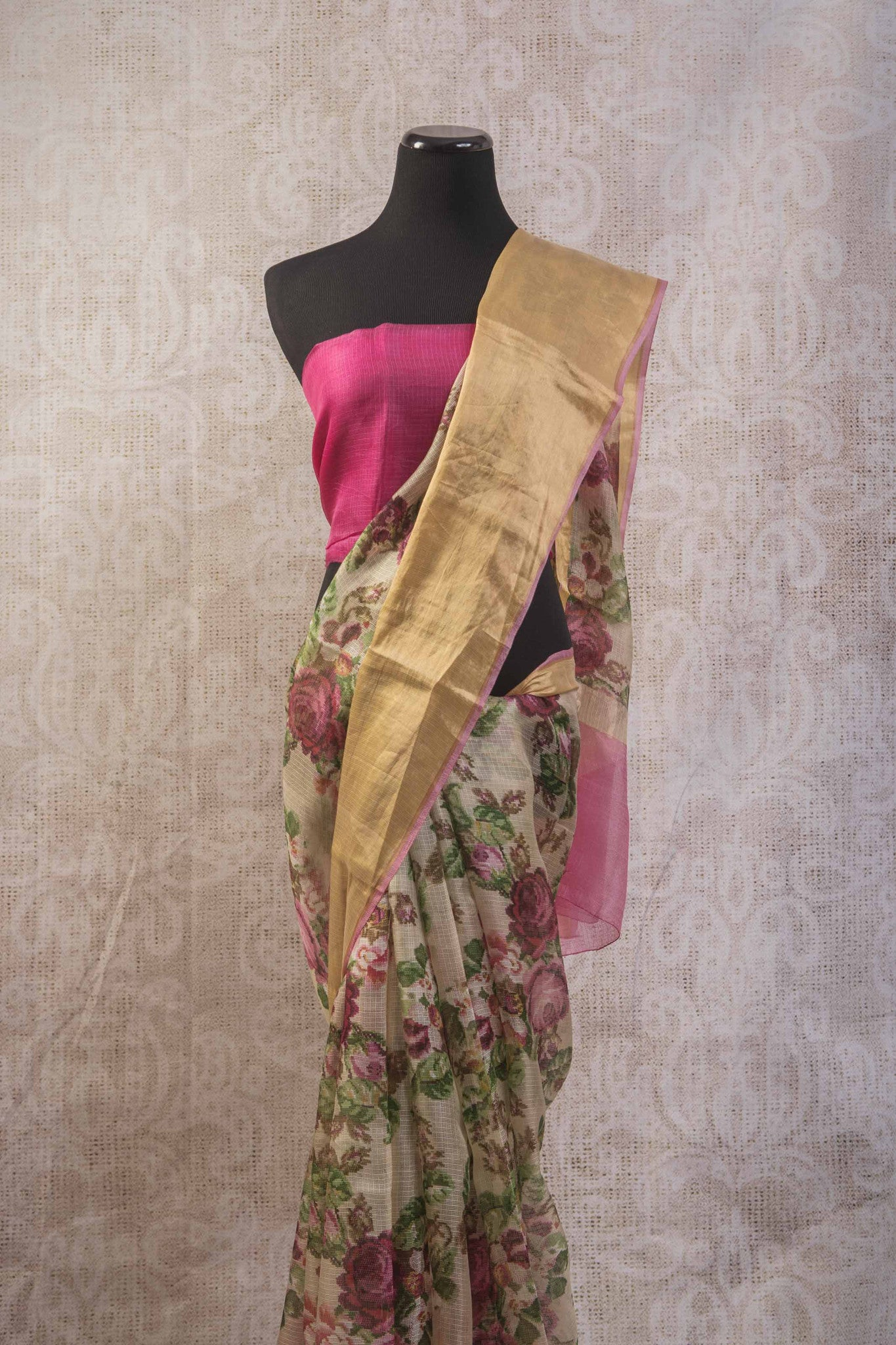 90b745 - Printed floral saree online at Pure Elegance with gold trim border and an un-stiched pink blouse piece. This zari kota saree is a great choice for any occasion.