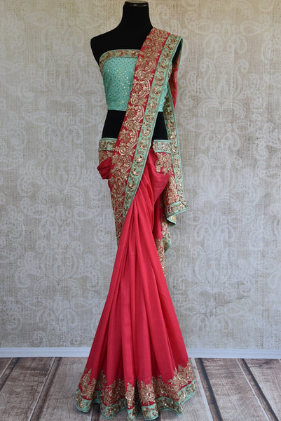 90b747 Pastel red & blue tissue georgette saree with golden embroidery. The heavy sari, available online at Pure Elegance makes for an ideal Indian outfit for weddings and is sure to turn heads where ever you go!