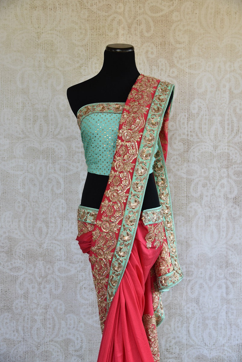 90b747 Pastel red & blue tissue georgette saree with golden embroidery. The heavy sari, available online at Pure Elegance makes for an ideal Indian outfit for weddings and is a great pick for this season!