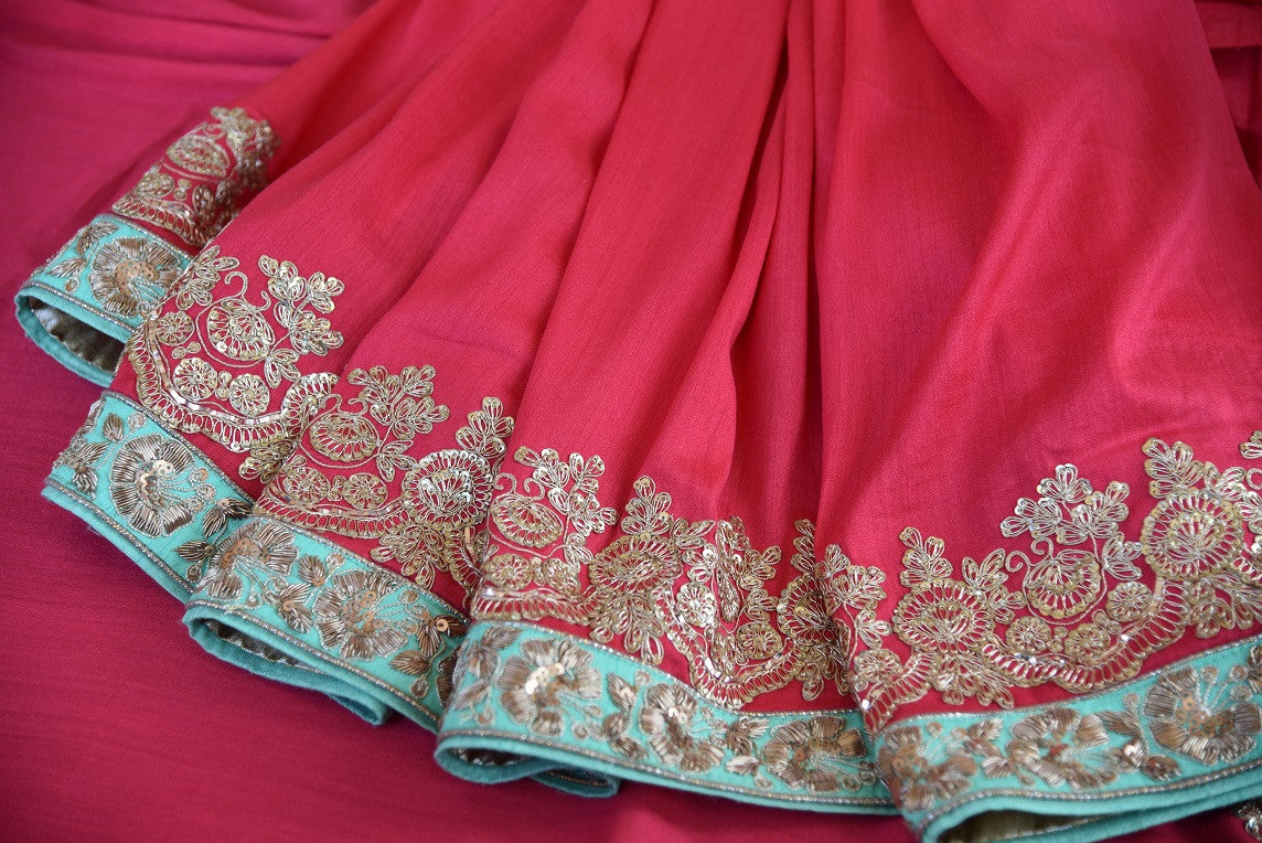 90b747 Traditional tissue georgette saree in a color combination of pastel red and blue with golden embroidery. The traditional sari, available online in USA at Pure Elegance makes for an ideal Indian outfit for weddings and is sure to wow!