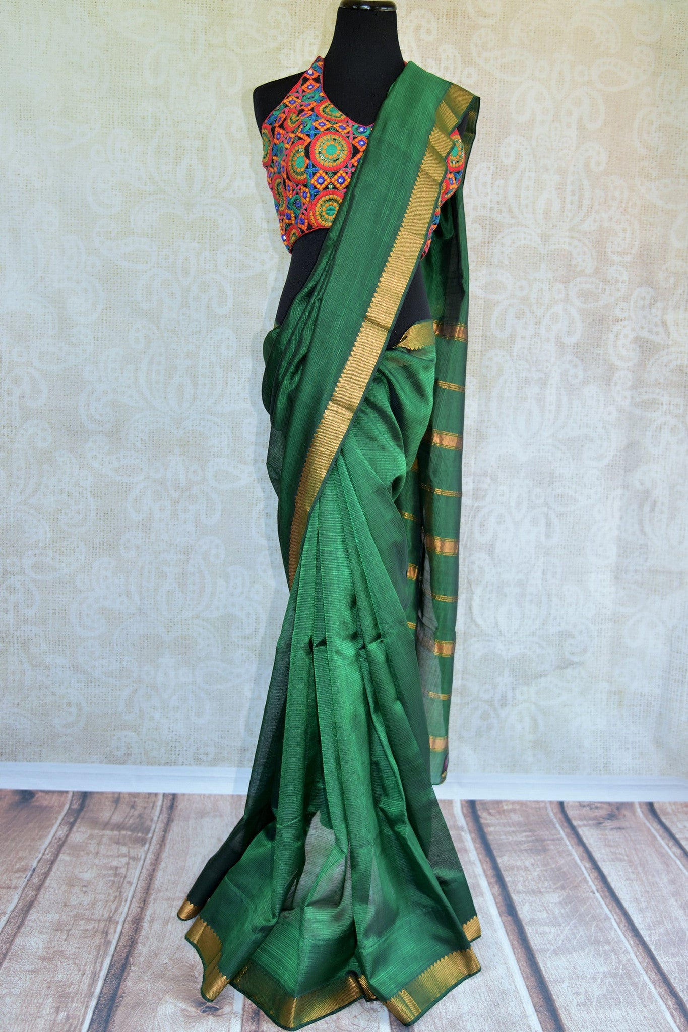 Beautiful green pure silk saree with gold trim border and stripes on pallu. Light weight casual saree.- Full view