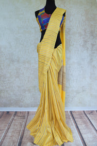 Buy Yellow khadi cotton silk saree with beige gold stripe. Graceful and tasteful sari perfect for Indian parties. -Full view