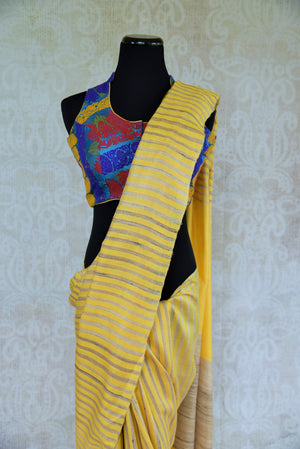 Buy Yellow khadi cotton silk saree with beige gold stripe. Graceful and tasteful sari perfect for Indian parties. -close up
