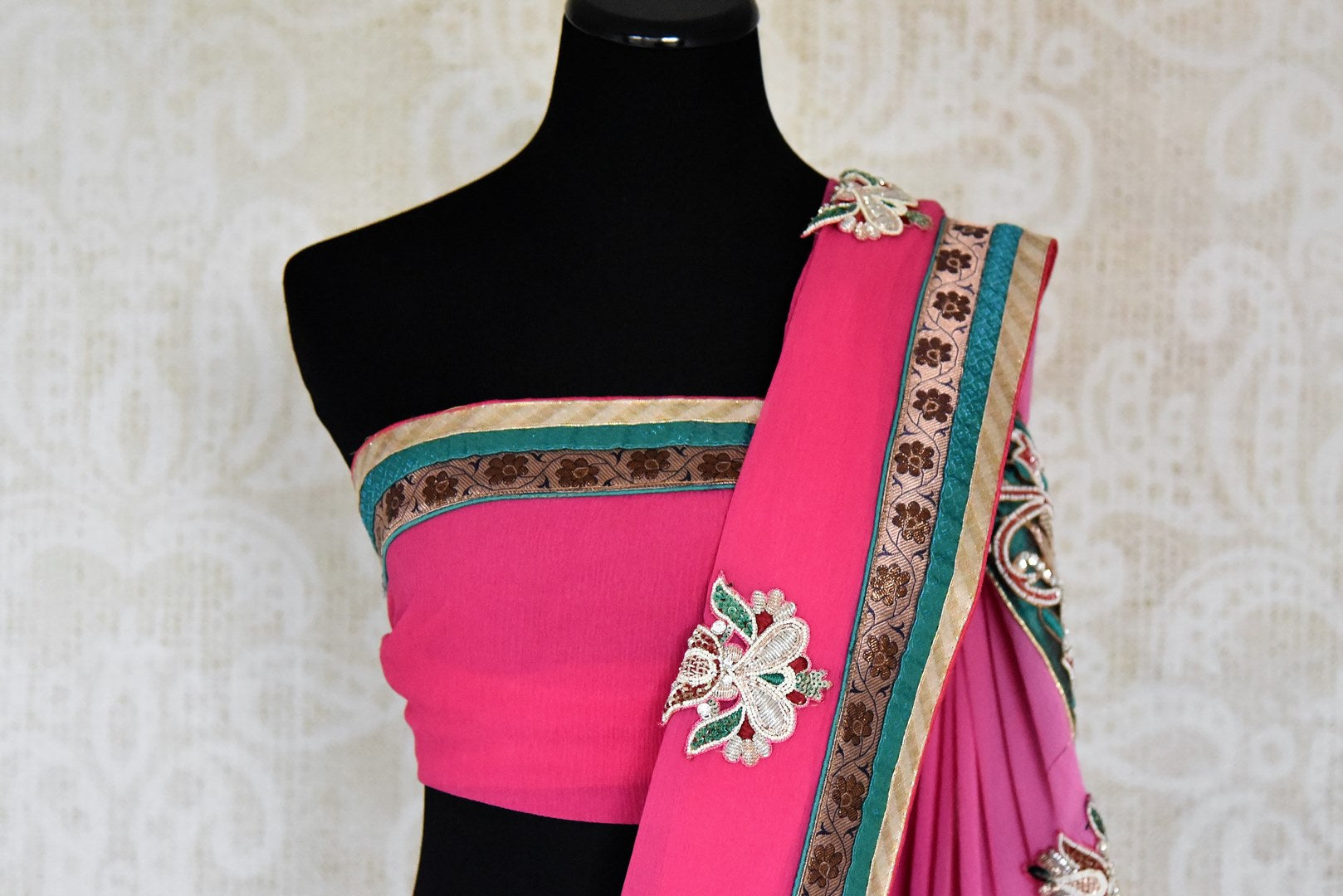 Buy pink embroidered fancy chiffon saree online in USA from Pure Elegance. Let your ethnic style be one of a kind with an exquisite variety of Indian handloom sarees, pure silk sarees, designer sarees from our exclusive fashion store in USA.-blouse pallu