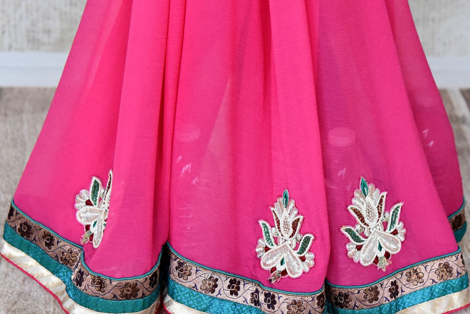 Buy pink embroidered fancy chiffon saree online in USA from Pure Elegance. Let your ethnic style be one of a kind with an exquisite variety of Indian handloom sarees, pure silk sarees, designer sarees from our exclusive fashion store in USA.-pleats