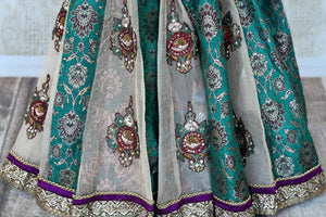 Buy sea green Banarasi and net embroidered saree with blouse online in USA from Pure Elegance. Let your ethnic style be one of a kind with an exquisite variety of Indian handloom sarees, pure silk sarees, designer sarees from our exclusive fashion store in USA-pleats