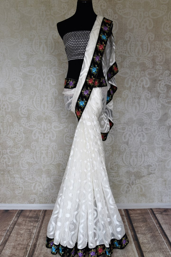 Buy white chiffon saree with black flower embroidery border online in USA from Pure Elegance. Let your ethnic style be one of a kind with an exquisite variety of Indian handloom sarees, pure silk sarees, designer sarees from our exclusive fashion store in USA.-full view
