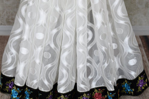 Buy white chiffon saree with black flower embroidery border online in USA from Pure Elegance. Let your ethnic style be one of a kind with an exquisite variety of Indian handloom sarees, pure silk sarees, designer sarees from our exclusive fashion store in USA.-pleat