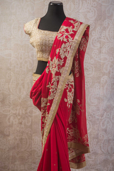90b805 Sheer red georgette saree with gold floral embroidery, pearl & gem encrusted. An ideal ethnic outfit for Indian weddings, buy this at our store - Pure Elegance at Edison, as well as online.