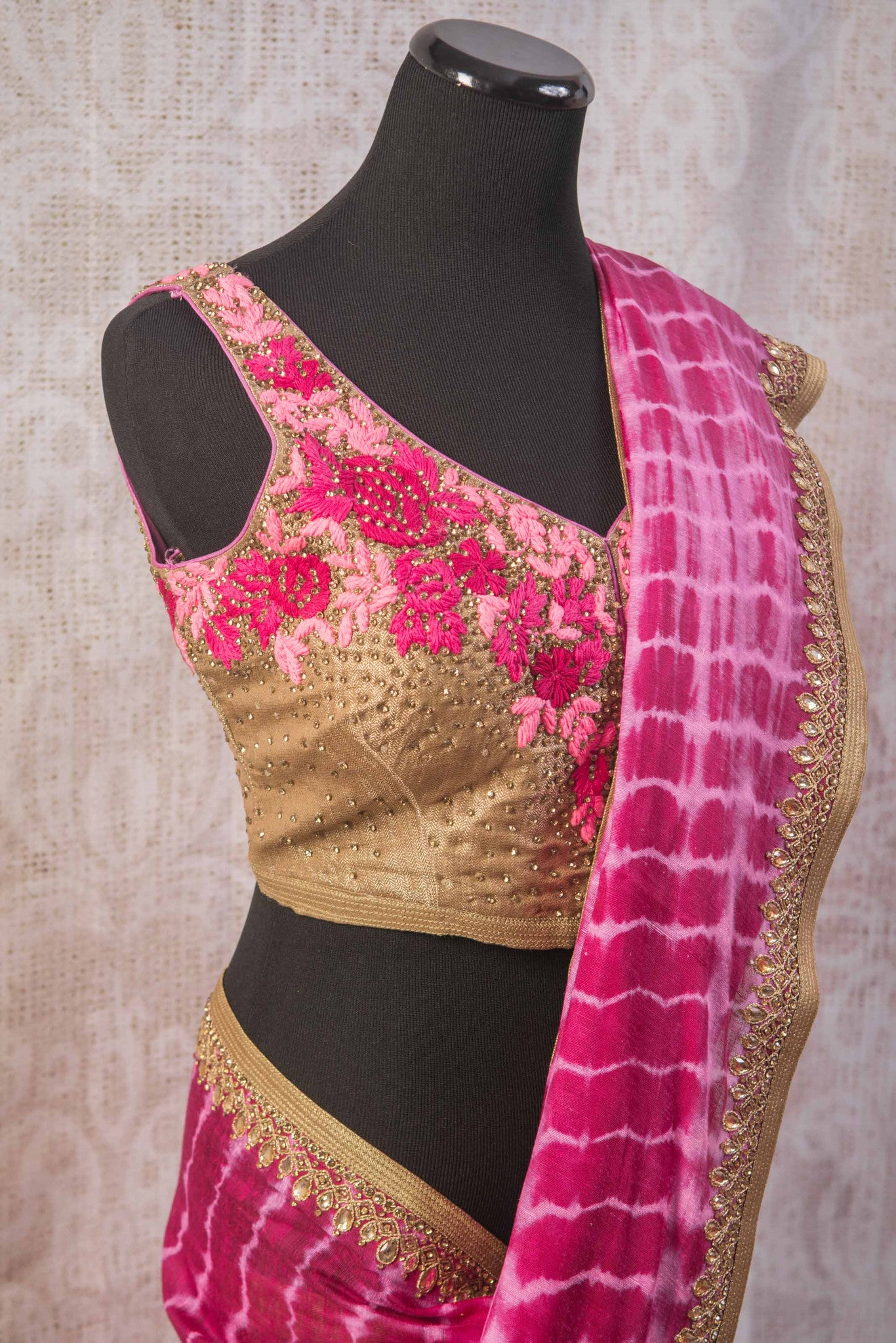 90b806 Indian tie dye saree with an embroidered blouse and border. The pink sari online in USA at our store Pure Elegance is wonderfully versatile and an absolute classic!