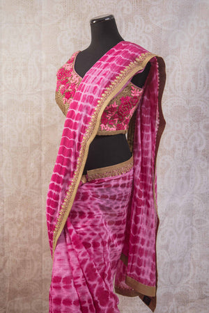 90b806 Tie dye saree with an embroidered blouse and border. The beautiful pink Indian sari online at Pure Elegance is sure to flutter hearts wherever you go!