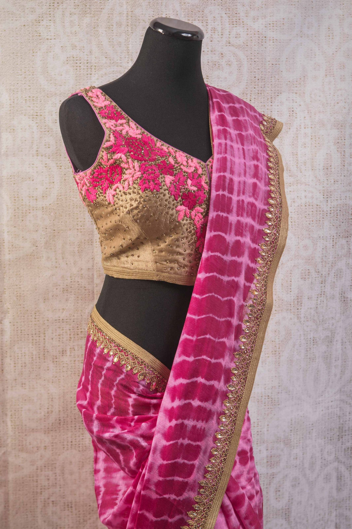90b806 Tie dye saree with an embroidered blouse and border. The beautiful pink Indian sari online at Pure Elegance is versatile and can be styled in very many ways!