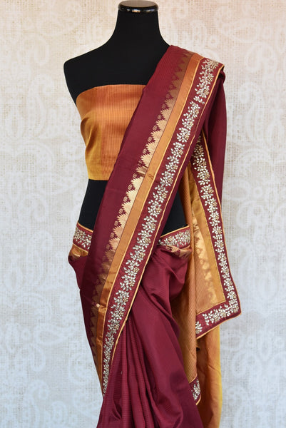 90B815 Buy this maroon saree with a pop of orange and kundan work on border online at our store - Pure Elegance in USA. The traditional Bangalore silk saree is a perfect ethnic outfit for pujas and Indian weddings.
