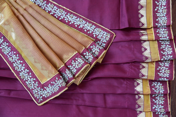 90B815 Buy this traditional maroon and orange saree with kundan work on border online at our store - Pure Elegance in USA. The Bangalore silk saree is an evergreen stunner!
